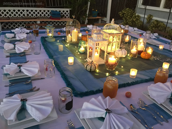 Candles and fairly lights on this outdoor dinner table. Read the details at my blog.
