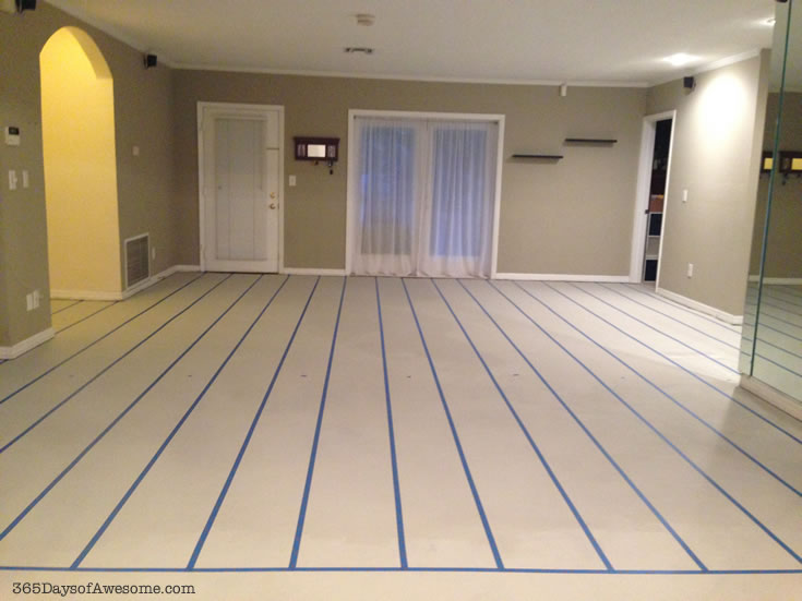 Painting the floors: Measure out the width and tape each line.